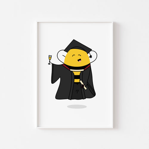 A photograph of our 'Clever Bee' graduation print on a white wall in a white frame -  featuring an illustration of a bee in a cap and gown holding a glass of champagne and a scroll tied with a bow, by Lulibell Studio.