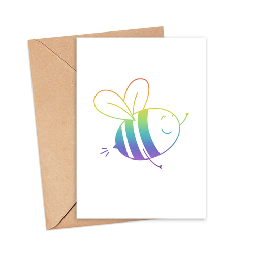Greetings card featuring an illustration of a rainbow-coloured bee, by Lulibell Studio.