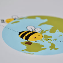 Load image into Gallery viewer, A close up photograph of our Travelling Bees print - three bees flying around the world - one holding tickets, one holding a suitcase, one wearing sunglasses, by Lulibell Studio.