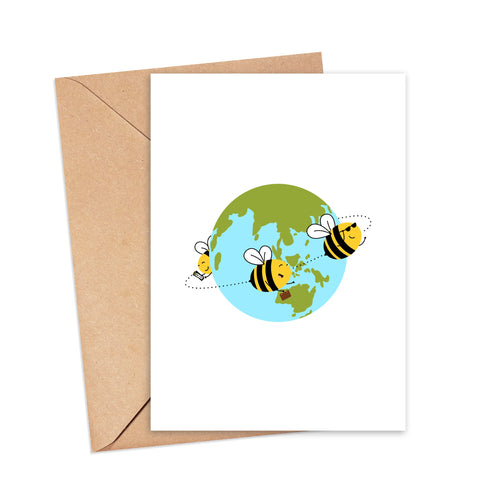 Greetings card featuring an illustration of three bees flying around the world - one holding tickets, one holding a suitcase, one wearing sunglasses, by Lulibell Studio.