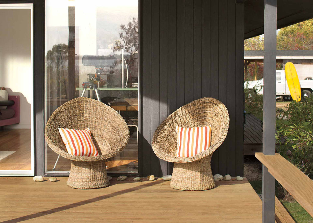 deck with two whicker chairs
