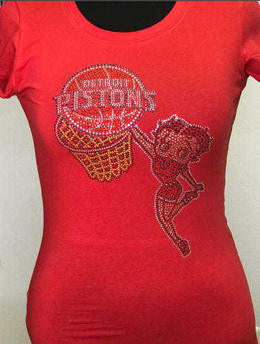 You have never looked so hot than you will if you are in this Betty Boop Pistons tee. This design will definitely get you noticed at any game. Formed Fitted Tee.