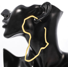 Load image into Gallery viewer, These African shaped earrings are perfect as a statement piece! Both gold and silver earrings are made of stainless steel.