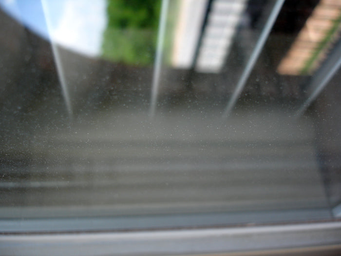 House window contaminated with paint overspray