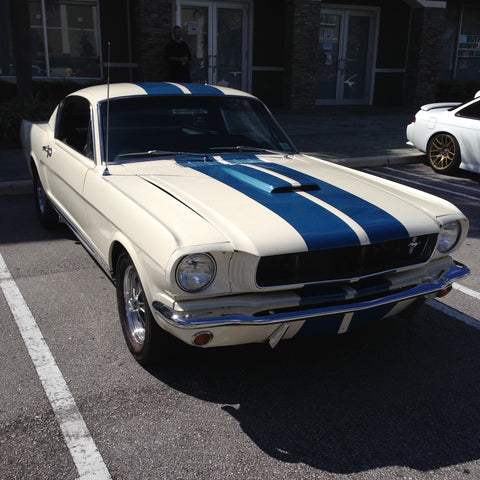 front view of a 1965 Ford Mustang GT350 fastback white with blue stripes
