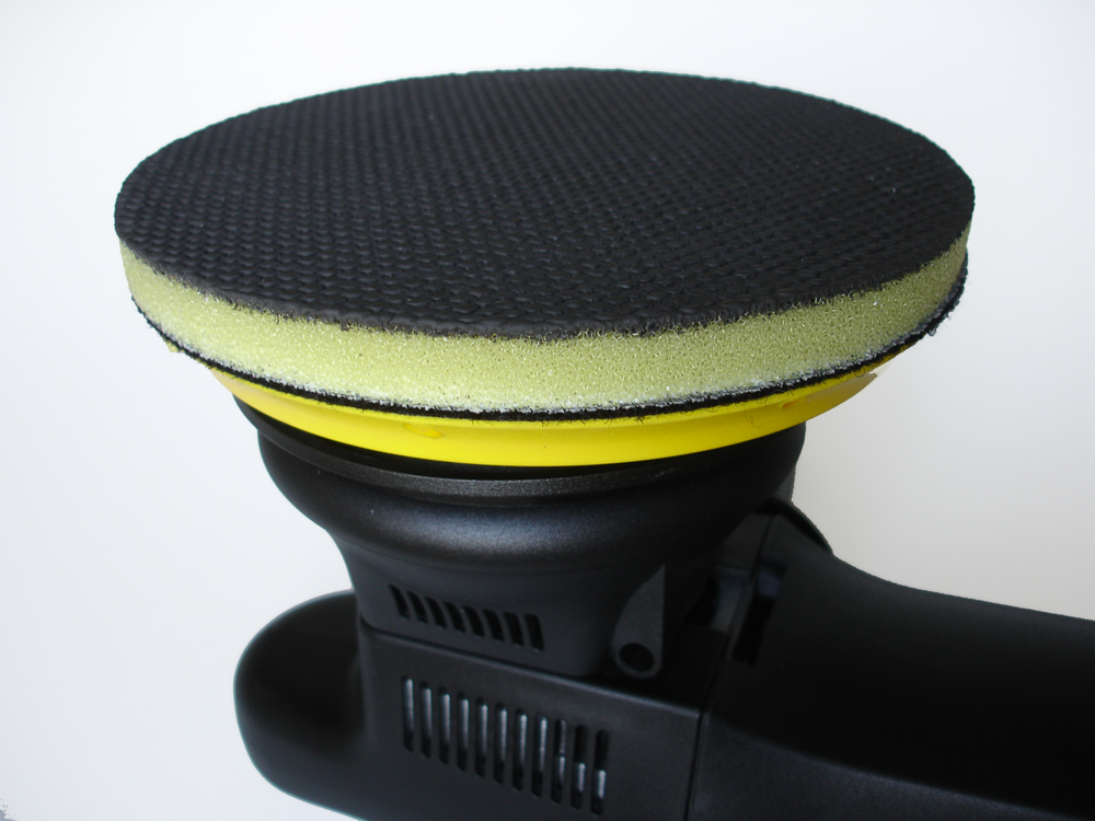 Klaren's Yellow Power Disc Clay Bar Pad on a Black Random Orbital Polisher