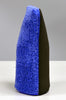 Klaren's royal blue fine grade microfiber wash mitt, standing tall, with an advanced synthetic clay surface.