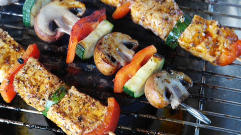 Vegetable and meat skewers on BBQ