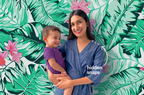 Woman with child in front of green leaf wallpaper