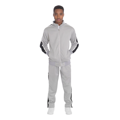A black person wears a grey jump suit