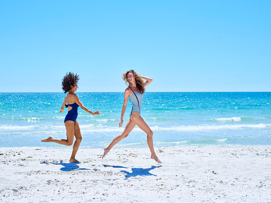 Charlotte and Elizabeth running on the beach