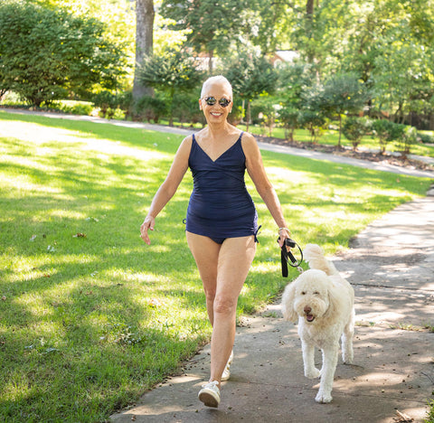 Jane walking dog in Navy Tankini