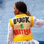 Image of the back view of model wearing 'Black & British' raffia embroidered vest