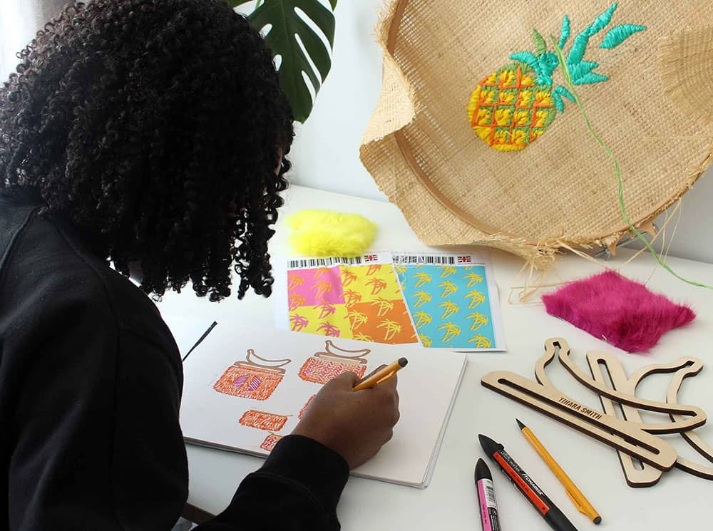 Tihara Smith drawing her bag designs