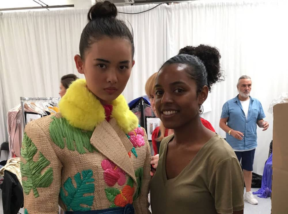 Designer - Tihara Smith with one of the models wearing one of the Windrush Collection pieces at Graduate Fashion Week