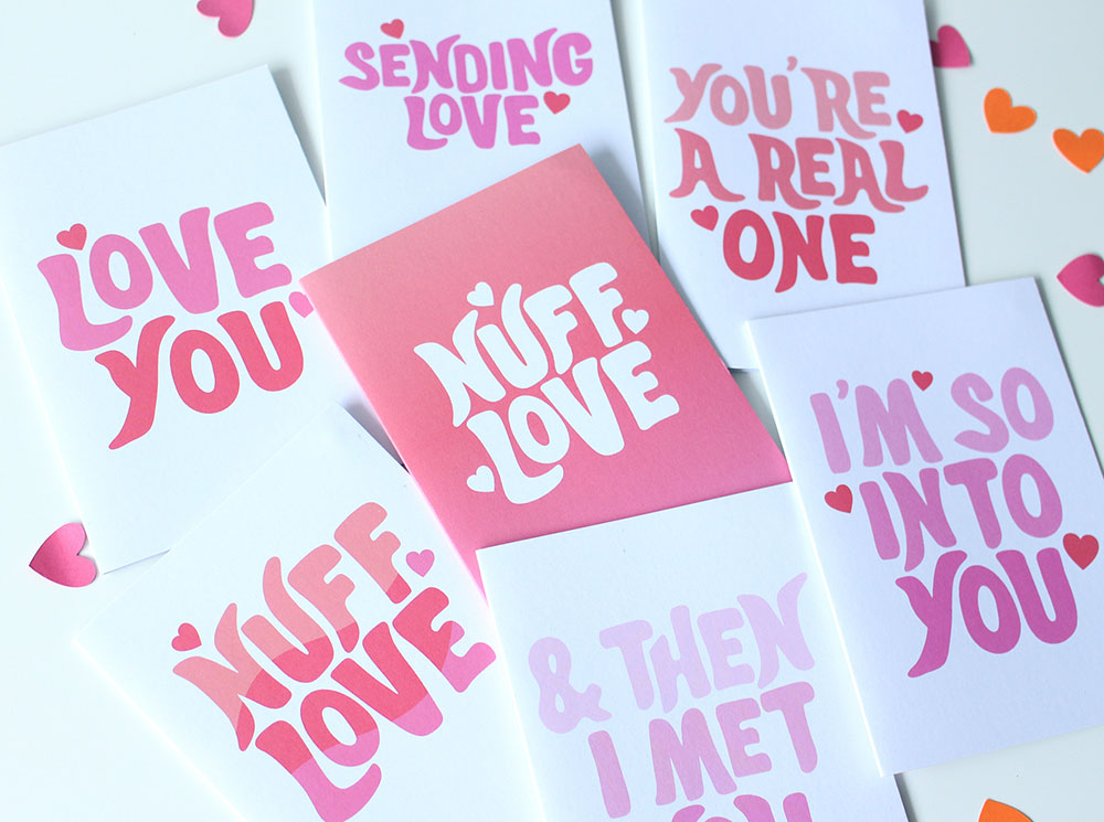 Image of Valentine's Day cards spread out on a white table