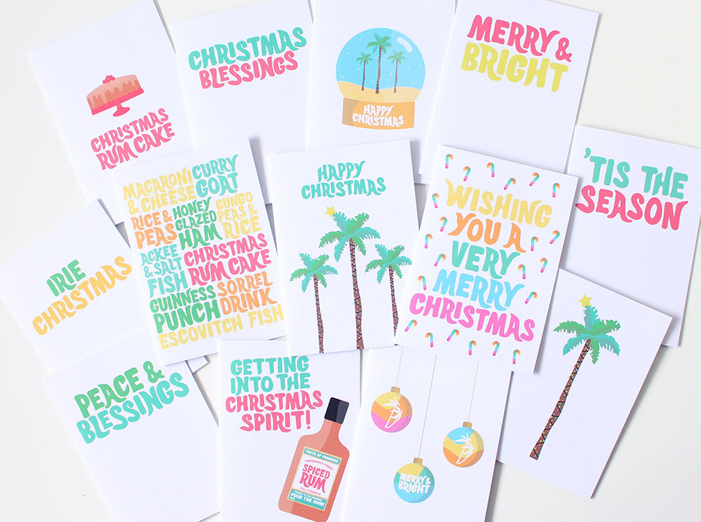 Image of all the tropical Christmas cards laid out.