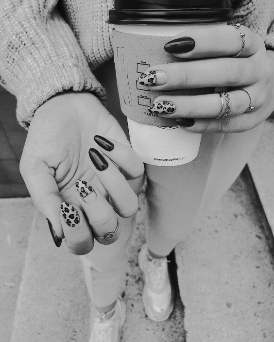 woman with nail polish holding a coffee