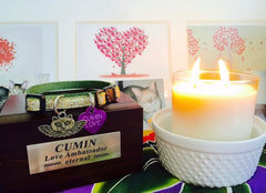 lit candle next to wooden box