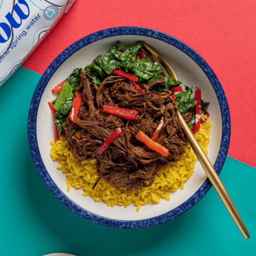 Pulled Beef Brisket Rendang with Sautéed Chinese Mustard Greens, Red Chili, Garlic & Lemon (Turmeric Coconut Rice)
