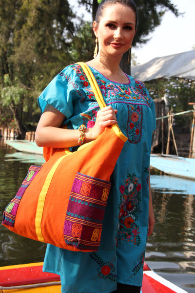 Orange and multi coloredi Hand woven tote with hand embroidered details