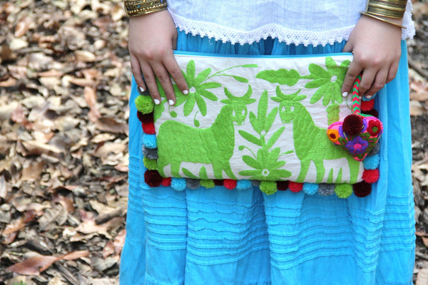 LIme green Otomi clutch with pompoms and hand embroidered tassels
