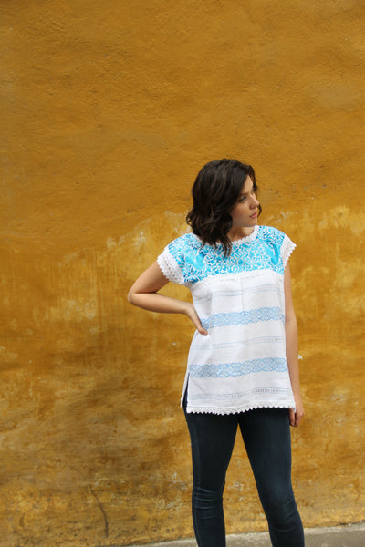 Small to medium  White and turquoise Two Birds de Paz hand woven and hand embroidered blouse