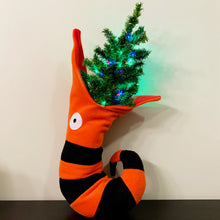 Load image into Gallery viewer, Picture of Christmas stocking that looks like an orange and black striped snake with a Christmas tree in its mouth.