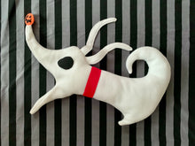 Load image into Gallery viewer, Soft fleece Christmas stocking made to look like a white ghost dog with a red collar and a jack o lantern for a nose. It's laying on a black and grey striped background.
