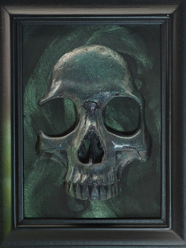 framed dark green glittery skull on a black and green background painted like there are wisps of magical cauldron smoke behind it. very reminiscent of the Slytherin house from Harry Potter.
