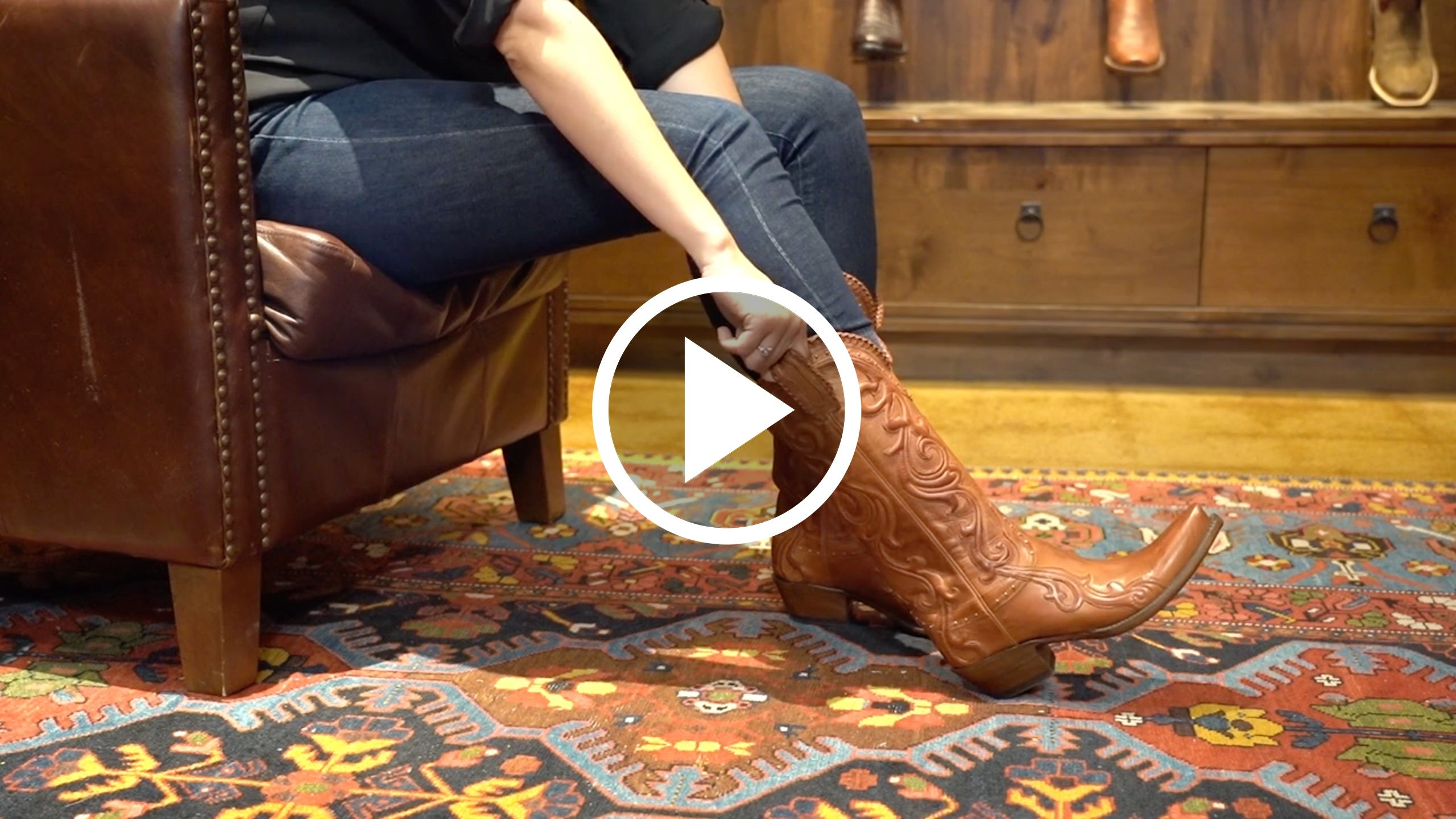 Play video for trying on a cowboy boot