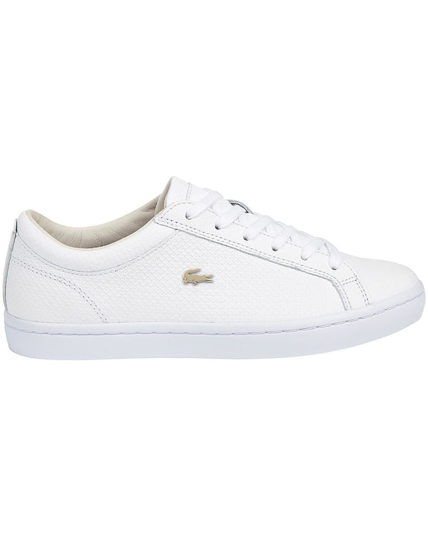 Side view of lacoste straightset leatner sneaker in white with gold alligator at side