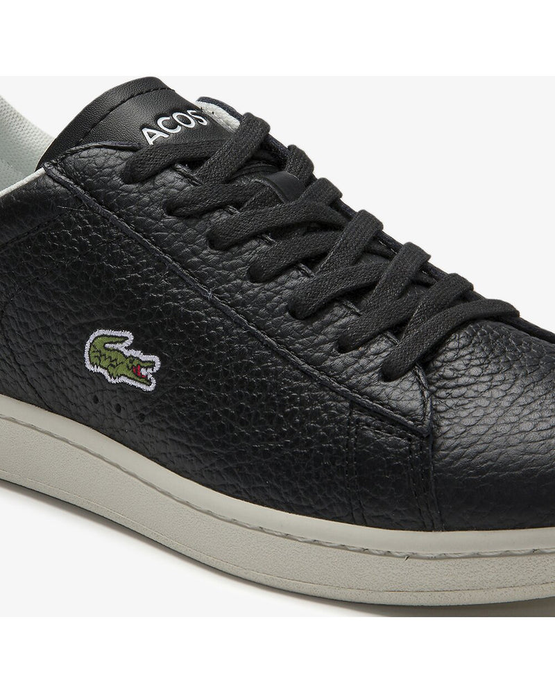 Close up side view of Lacoste carnaby evo tumble leather black sneaker with green alligator