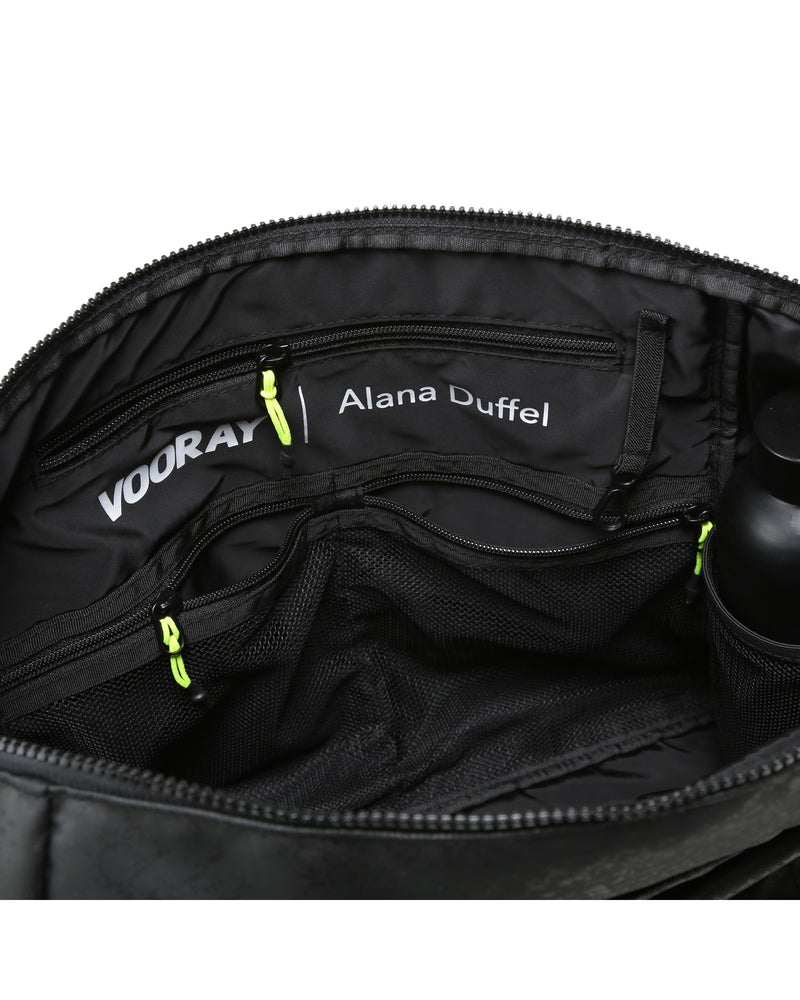 Close up view of inside pockets of alana duffel bag in black snakeskin