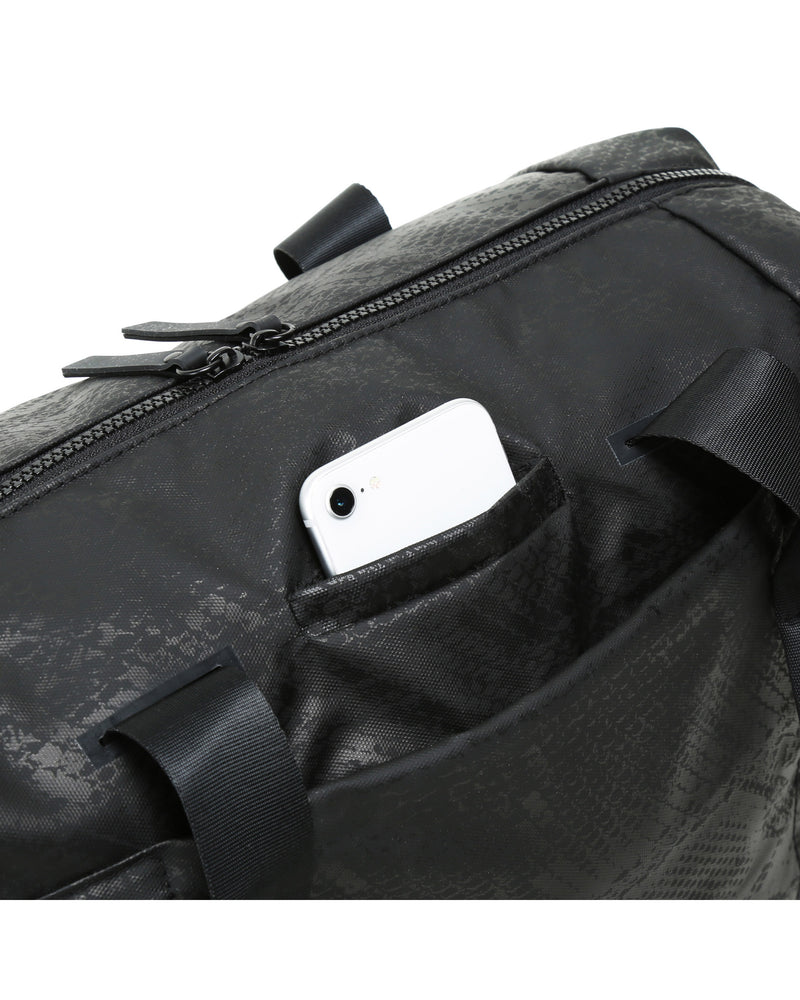 Close up view showing phone pocket on Black snakeskin alana duffel bag