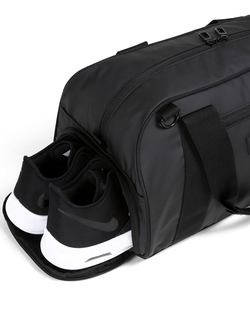 Side view of matte black burner gym duffel bag showing zip shoe compartment
