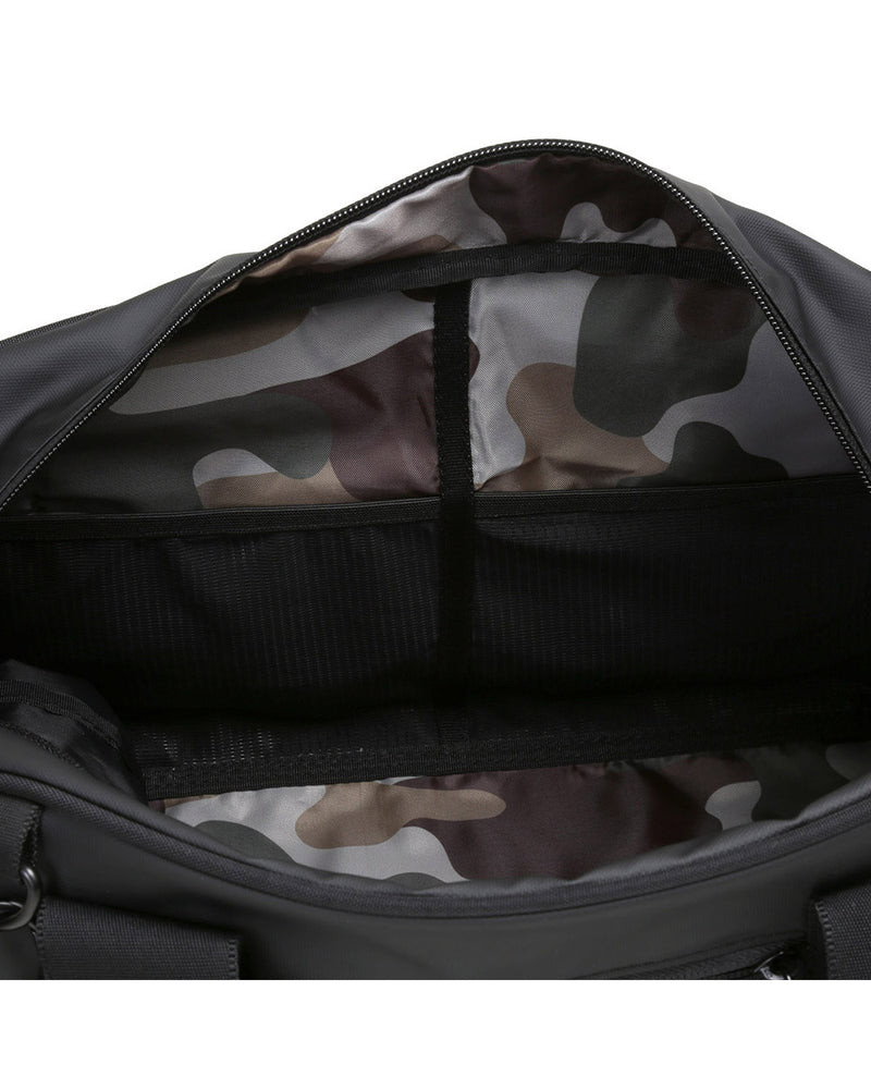 top view of opened matte black burner gym duffel bag showing camo lining
