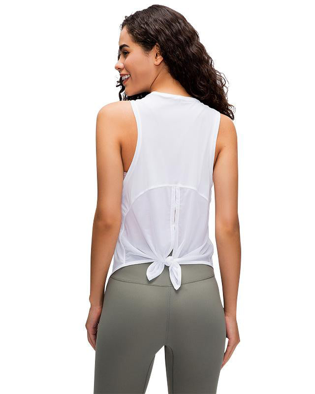 Rear view of model wearing white mesh tank with tie at back