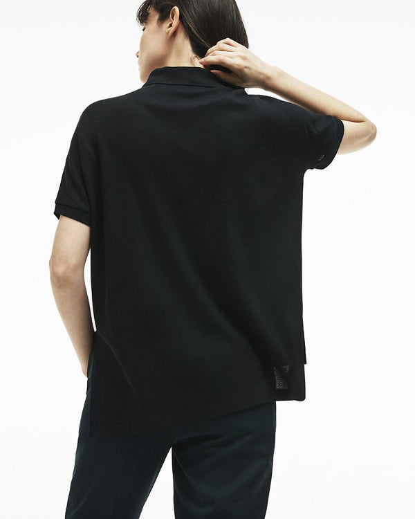 Back view of model wearing lacoste relaxed fit polo in black