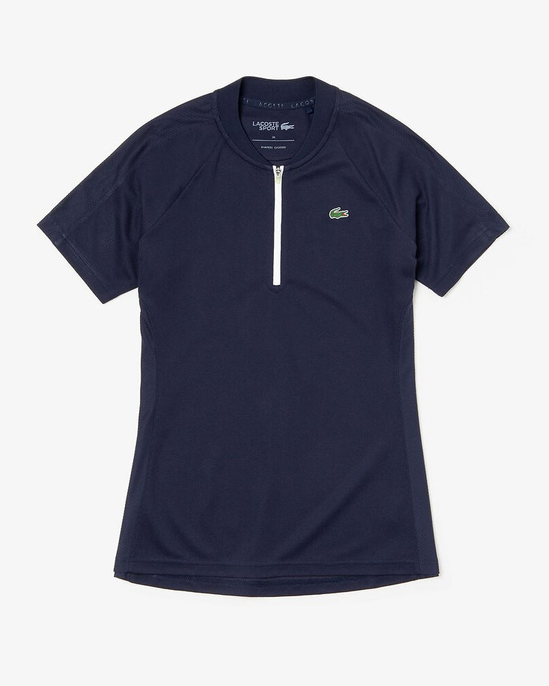 Front view of Lacoste Golf waffle polo in navy with white half zip and green alligator on chest