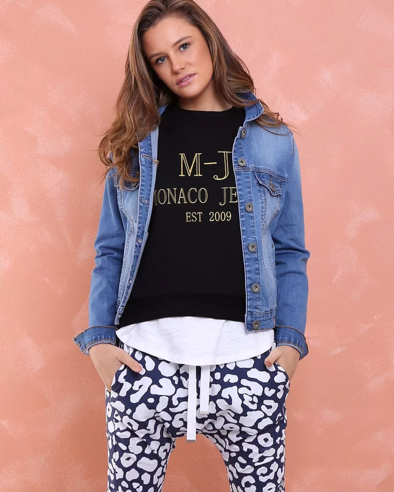 Model wearing monaco jeans dylan denim jacket in sand blue wash