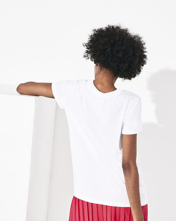 Back view of model wearing lacoste tennis logo jersey t shirt in white and clafouti