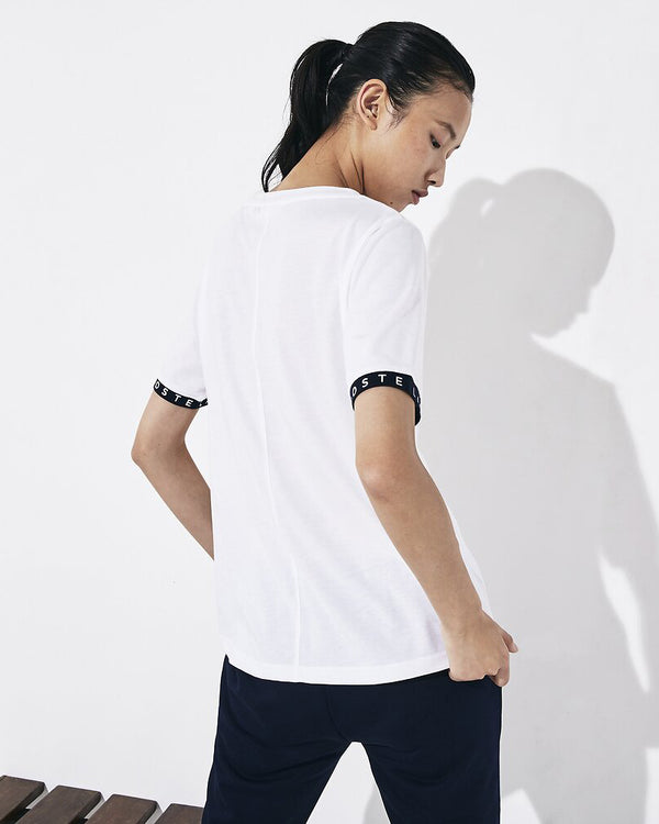 Back view of lacoste tennis flud jersey t shirt in white and navy with green alligator on chest