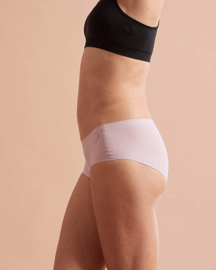 Side view of model wearing dusky pink buddhi brief
