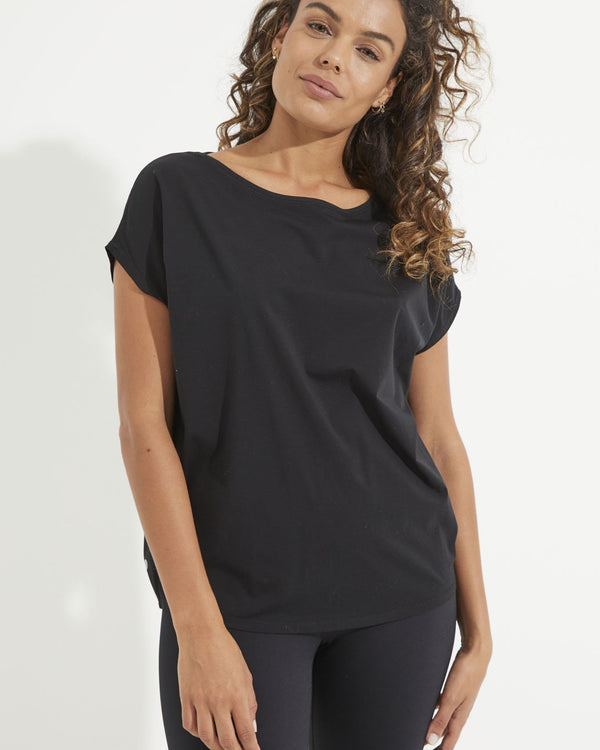 Model wearing black short sleeve tee with black leggings
