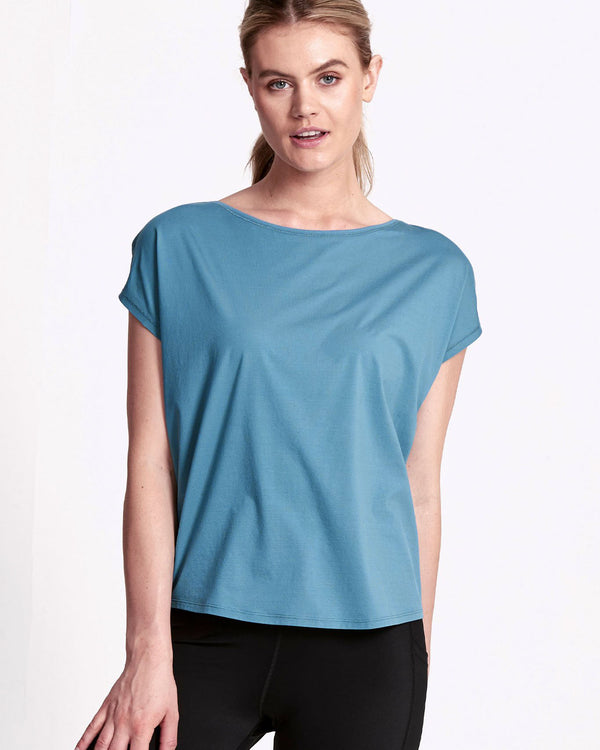 Model wearing teal short sleeve tee