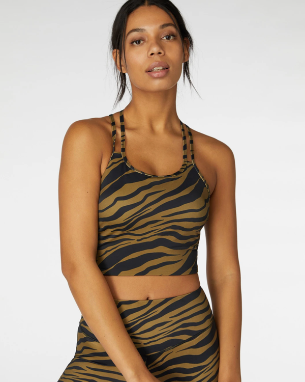 Model wearing activewear crop in black with brown tiger print