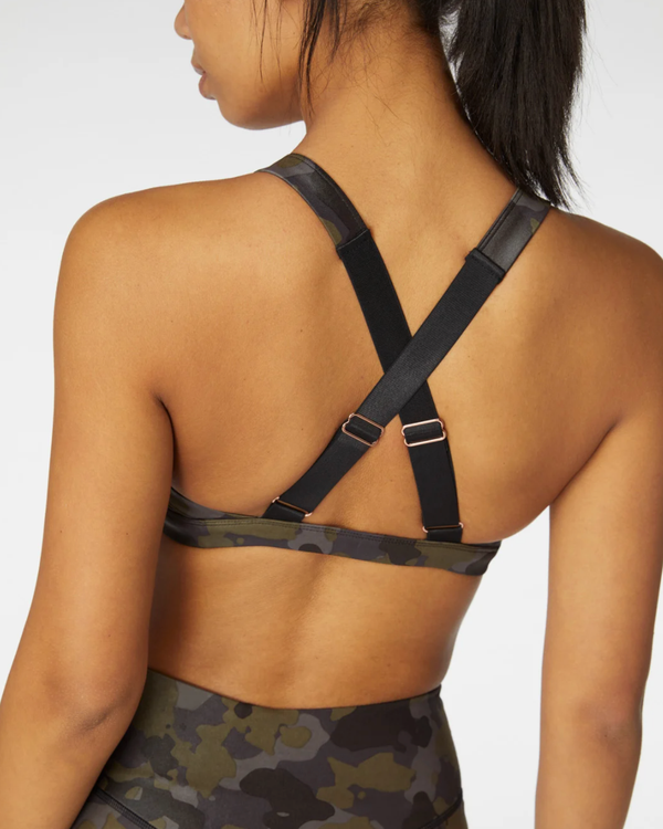 Model wearing activewear bralette with criss cross back straps