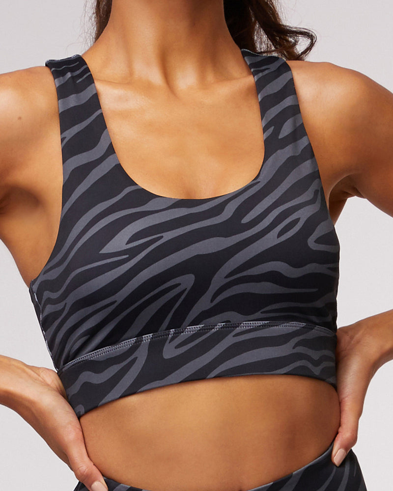 Close up front view of model wearingl'urv savanna crop in charcoal with matching leggings