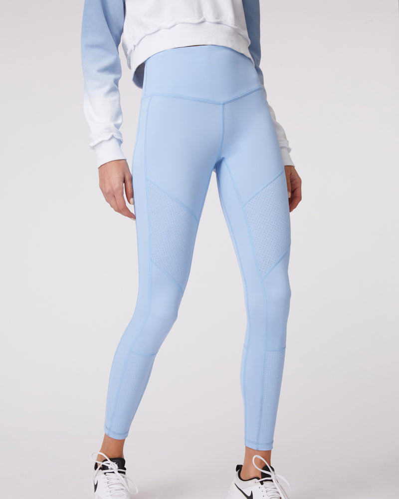 Close up front view of model wearing l'urv nebula legging in soft blue